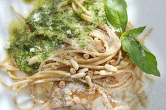 Wholemeal Spaghetti With Basil Pesto And Pine Nuts Royalty Free Stock Photos
