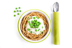 Wholemeal spaghetti with pea cream sauce from above Stock Photography