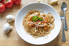 Wholemeal spaghetti with sauce of tomatoes, mushrooms and parmes Stock Photos