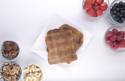Wholemeal toast surrounded by fruit Royalty Free Stock Images