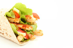 Wholemeal tortilla wrap. With chicken stripes and lettuce Stock Image