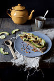 Wholemeal vegan toast with avocado slices and black sesame seeds Royalty Free Stock Images
