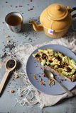 Wholemeal vegan toast with avocado slices and black sesame seeds on table with teapot Stock Photography