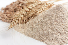 Wholemeal wheat flour and ears of wheat Stock Images