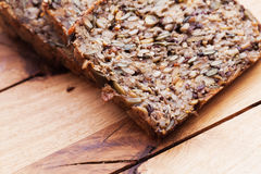 Wholemeal, wholewheat bread on wooden table. Organic, healthy food Stock Photography