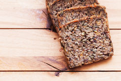 Wholemeal, wholewheat bread on wooden table. Organic, healthy food Stock Image