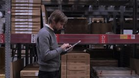 Wholesale, logistic, business, export and people concept - happy man or manager with tablet pc computer at warehouse stock video footage