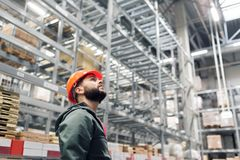 Wholesale, logistic, people and export concept - manager or supervisor with tablet at warehouse. Looking thoughtfully at the top stock photos