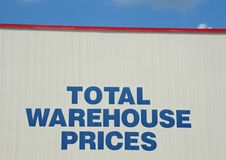 Wholesale warehouse grocery store sign. A grocery store is a retail store that primarily sells food. A grocer is a bulk seller of food. Grocery stores often Royalty Free Stock Photos