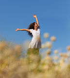 Wholesome brunette woman outdoors in a field Royalty Free Stock Photos