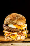 Wholesome egg and bacon burger Royalty Free Stock Images