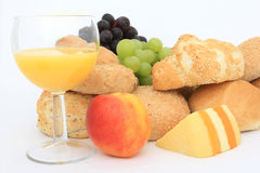 Wholesome healthy continental breakfast food. Wholesome healthy breakfast food, bread, cheese, red and green grapes, orange juice, isolated on white, copy space Stock Image