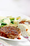 Wholesome meal. A wholesome meal with beef, mashed potatoes and asparagus with hollandaise sauce Royalty Free Stock Images