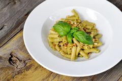 Wholesome Pasta. Penne Pasta with Pesto Sauce. Royalty Free Stock Photography