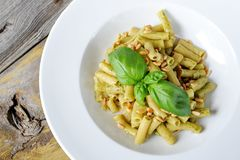 Wholesome Pasta. Penne Pasta with Pesto Sauce. Stock Photography
