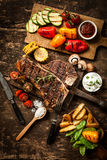Wholesome spread with t-bone steak and veggies Royalty Free Stock Image