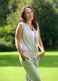 Wholesome woman smiling in the park Royalty Free Stock Image