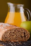 Wholewheat bread with apple and juice Stock Photography
