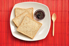 Wholewheat Bread with jam on red background Stock Photography