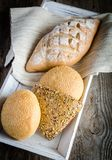 Wholewheat bread with sesame and flax-seed buns Stock Images