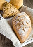 Wholewheat bread with sesame and flax-seed buns Stock Photography