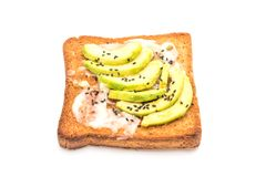 Wholewheat bread toast with avocado. Isolated on white background Stock Photo