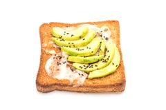 Wholewheat bread toast with avocado. Isolated on white background Stock Image