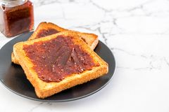 Bread toast with chili paste. Wholewheat bread toast with chili paste stock images