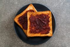 Bread toast with chili paste. Wholewheat bread toast with chili paste royalty free stock image