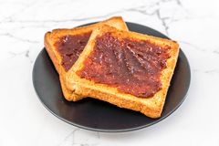 Bread toast with chili paste. Wholewheat bread toast with chili paste royalty free stock photo