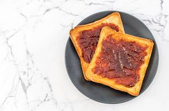 Bread toast with chili paste. Wholewheat bread toast with chili paste stock image