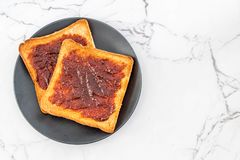 Bread toast with chili paste. Wholewheat bread toast with chili paste royalty free stock images
