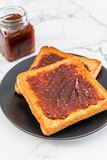 Bread toast with chili paste. Wholewheat bread toast with chili paste stock photo