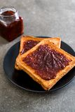 Bread toast with chili paste. Wholewheat bread toast with chili paste stock photos