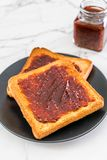 Bread toast with chili paste. Wholewheat bread toast with chili paste royalty free stock photos