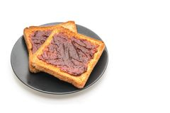 Wholewheat bread toast with chili paste. Isolated on white background stock photography