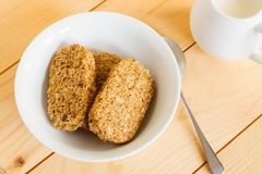 Wholewheat Breakfast Biscuit Cereal. With a jug of milk Royalty Free Stock Photography