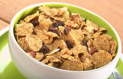 Wholewheat Cereal with Dried Fruits. Wholewheat cereal with dried fruit, raisin, walnut and almond in bowl (Selective Focus, Focus in the middle of the bowl Stock Image