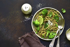 Wholewheat organic pasta with green vegetables.Top view with cop Stock Image
