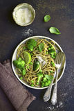 Wholewheat organic pasta with green vegetables.Top view. Royalty Free Stock Photos