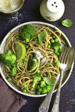 Wholewheat organic pasta with green vegetables.Top view. Stock Photos