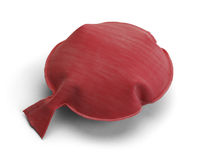 Whoopee Cushion. Red Rubber Noise Maker Isolated on a White Background Royalty Free Stock Photo