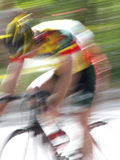 Whoosh!. Blur of professional bicycle racer pushing to maintain his position in a criterium royalty free stock photo