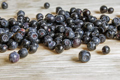 Whortleberry on a light board. Ripe whortleberry on a light board Stock Photography
