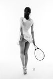 Whos game. Woman tennis player itching her bum Royalty Free Stock Photo