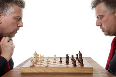Whos going to win. Man playing chess against himself shot in the studio Stock Photography