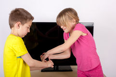 Whose the remote control? Royalty Free Stock Image
