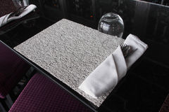 Whte dining set on black marble table. Royalty Free Stock Photos