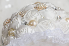 Whtie glam rose and pearl bridal bouquet Stock Photography