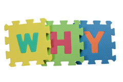 Why. Alphabet blocks forming the word WHY isolated on white background stock image